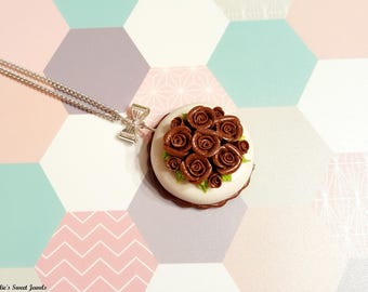 Covered with roses polymer clay cake necklace