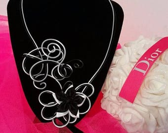 Handmade black and silver with black and white satin flower