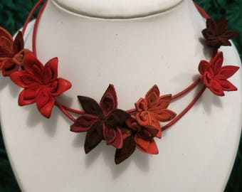 Shades of red, hand stitched leather flower NECKLACE.