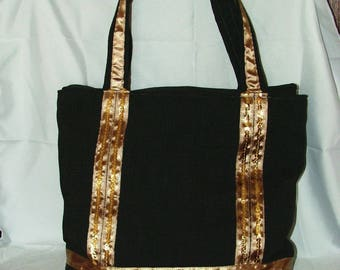 bag in Brown fabric with gold bands