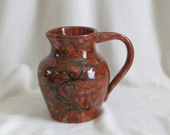 Iron red glazed stoneware jug