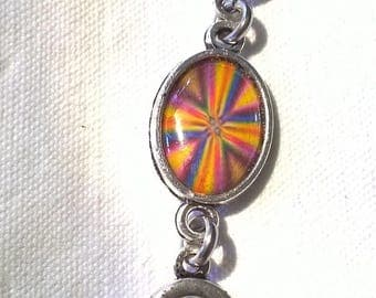 Bronze color cabochon bracelet spring cross Center. Just got colored
