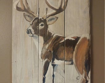 Buck on wooden fence