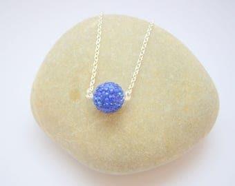 Women in Korean blue rhinestone necklace