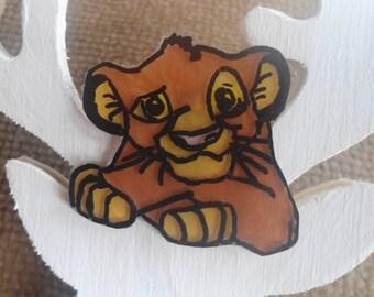 Brooch of a lion cub, Brown, black