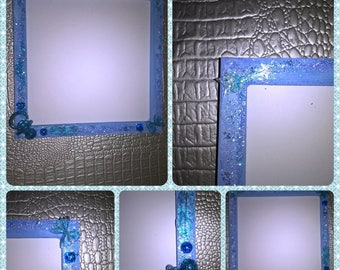 Wood frame stained blue with resin decorations