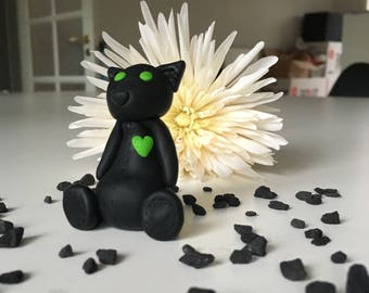 Black panther with green details