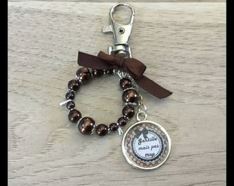 "Bag charm ""nice but not too"" with satin ribbon and glass beads."