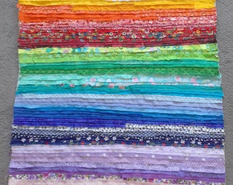 Decorative pillow with rainbow coloured strips