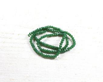 35 dark green faceted abacus glass beads approximately 3 to 4mm x 2.5 to 3mm