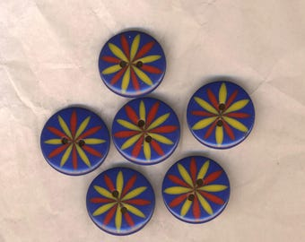 Six round buttons, red and Yellow Sun on blue print