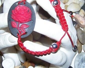 red rose cameo bracelet on black background