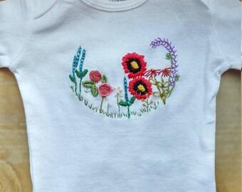 Hand embroidered English garden baby girl onesie