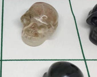 Carved skulls of crystal and or precious minerals . Please choose the skull of choice by the grid placement .  Example B2  or C1