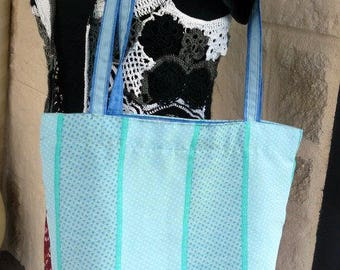 large bag lined, blue and green