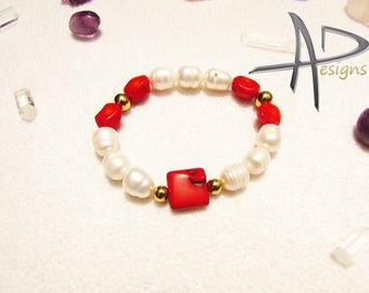 Bracelet of pearls river and red corals