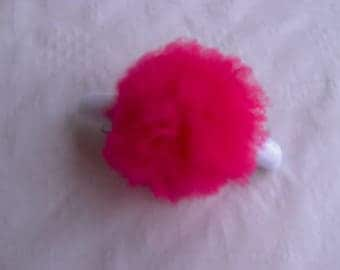 Hot pink hair clip adorned with white TASSEL