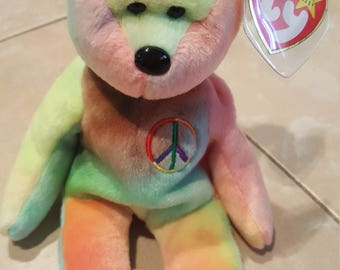 Mint condition peace bear beanie baby with tag protector