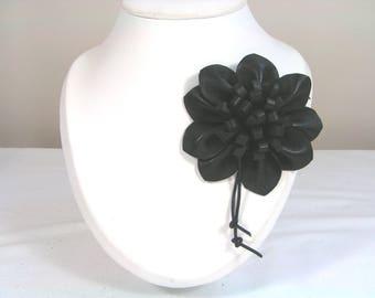 Brooch flower black lambskin leather understated and elegant
