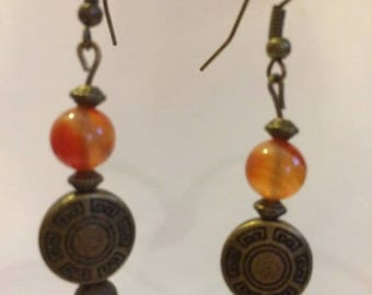 Bronze earrings with engraved circles and carnelian beads