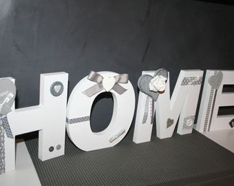 HOME letters in wood tones, white and gray hearts for standing or hanging