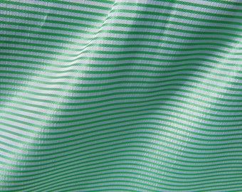 Green and white striped synthetic fabric 50 cm