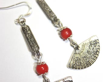 Earrings mounted with a variety of coral beads and silver.