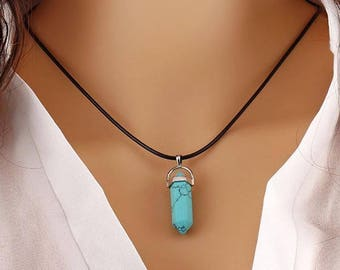 Turquoise pendant in a silver plated cage with a faux leather thong