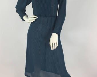 1970s turquoise striped secretary dress