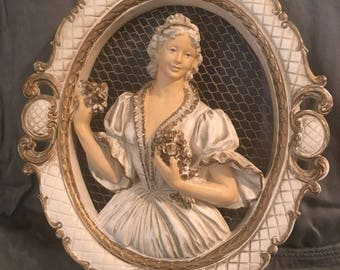 Three dimensional lady wall hanging. Plaster of Paris