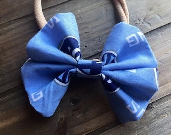 Baby girl bow on nylon headband or hair clip