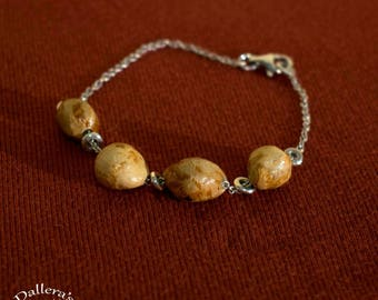 Silver bracelet with beech wood.