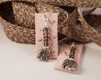 Polymer clay dangle earrings. Pink silver-leaf elephant.