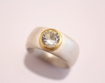 Silver ring with gold version and Beryl