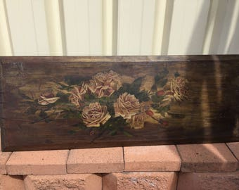 Hand painted roses on old board