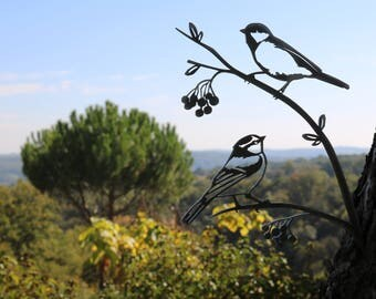These chickadees metal corten brighten and liven up your garden.
