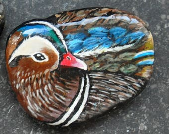 Duck figure painted on stone