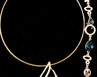 Gold choker with gemstone/rhinestone charm and bracelet