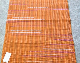 Rag Rug reuse cotton knit sheets tshirts 36 inches long by 27 inches wide bright orange hand made floor rug
