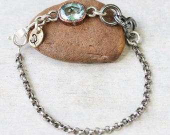 Oval faceted blue topaz bracelet in copper bezel setting and sterling silver oxidized rolo chain