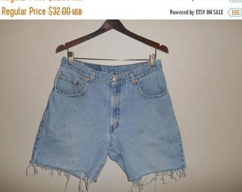 Closing Shop 40%off SALE Levi's 560  Vintage Jeans    90's  zip Fly cutoffs cut off festival Denim Jean Shorts  red tab  W 33