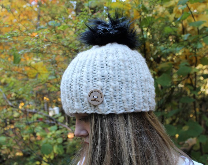 Hand Knit Merino Wool hat with faux fur pom pom.  Super warm and soft.  One size fits most adults.