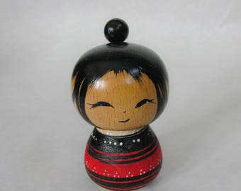 Little red Kokeshi