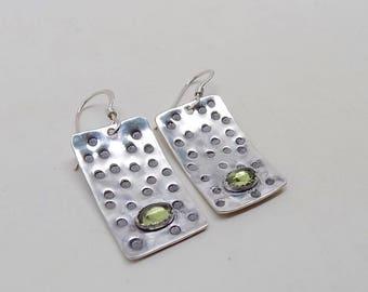 Peridot  earrings set in silver sterling.