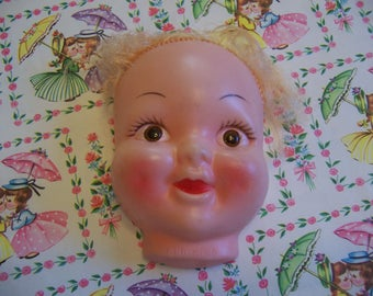 plastic doll head with life like brown eyes