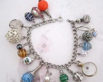 ON SALE- silver tone OOAK charm bracelet with vintage components - j6209