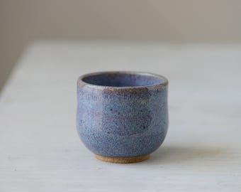 1 Wheel thrown small thick stoneware  cup  with pretty purple glaze holds 1/2 cup