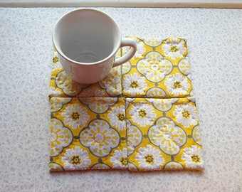 yellow and grey hand quilted set of mug rugs coasters