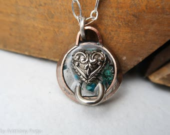 Collared heart set in hand hammered year 1967 US quarter pendant featuring turquoise shards and Oklahoma red dirt