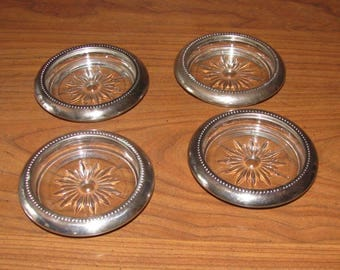Silver rimmed crystal coasters or ashtrays